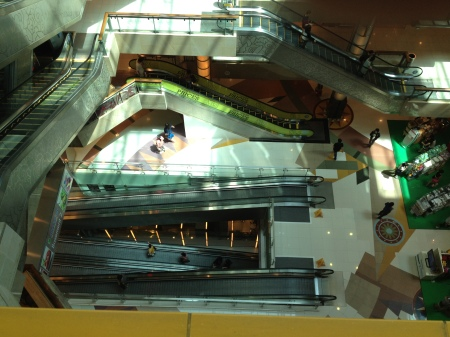 A pit of escalators in one of the many mall complexes in Singapore