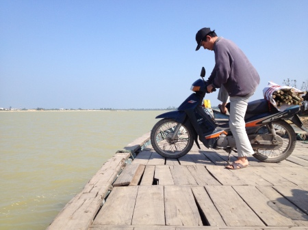 Ferries in Hoi An have a special dock for motorbikes: suitable for local men and women who conduct business on multiple islands