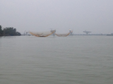 A blurry depiction of traditional fishing nets