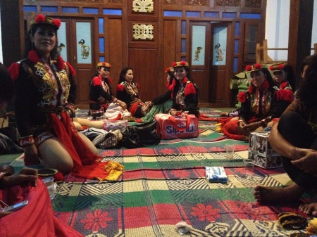 "Women preparing for their ritual/dance performance. This dance genre is known as ""angguk"" and is most often performed by women.    This dance ritual is rejected by most of the conservative religious powers in Java."