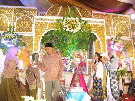 Zie's parents on stage after being requested to sing at the reception
