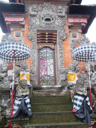 Gates of the local temple, Pura Dalem. The two figures on the door represent the polar forces of Hindu cosmology.